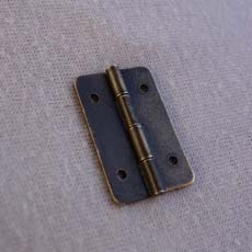 Small antique hinge